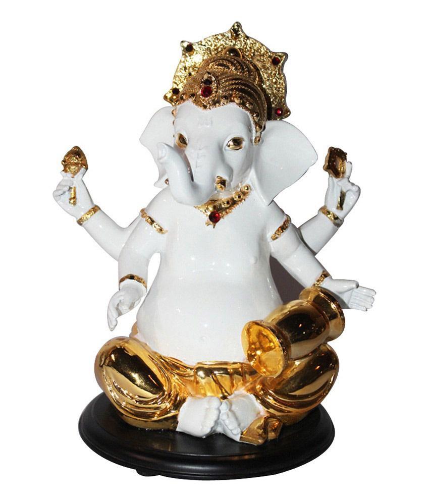 Saanvi Enterprises Gold And White Polystone Musician Ganesha Idol With Drum